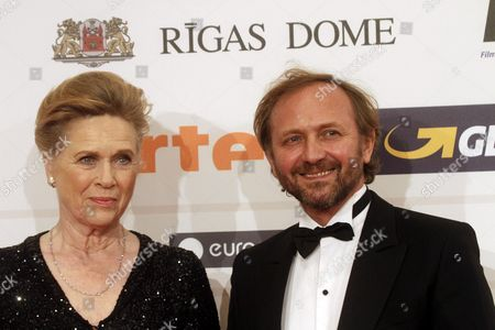 Stock Photo of Norwegian Actress and Film Director Liv Ullmann (l) and Polish Actor Andrzej Chyra Arrive on the Red Carpet For the 27th European Film Awards at the Latvian National Opera in Riga Latvia 13 December 2014 Latvia Riga