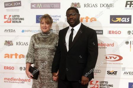 British Director Steve Mcqueen (r) and His Wife Bianca Stigter Arrive on the Red Carpet For the 27th European Film Awards at the Latvian National Opera in Riga Latvia 13 December 2014 Latvia Riga