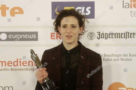 English Composer Mica Levi Poses with Her European Film Award For European Composer 2014 at the Press Room During the 27th European Film Awards at the Latvian National Opera in Riga Latvia 13 December 2014 Latvia Riga