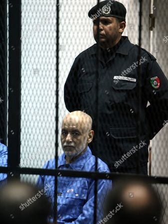 Stock Picture of Former Libyan Prime Minister Baghdadi Al-mahmoudi Looks on As He Sits Behind Bars During His Trial in Tripoli Libya 18 February 2014 Al-mahmoudi Faces Charges of Involvement in Crimes Under the Gaddafi Rule Which was Toppled in 2011 He Served As Prime Minister From 2006 Until August 2011 when He Fled to Tunisia After Insurgents Seized Control of Tripoli Virtually Ending Gaddafis 42-year Rule Tunisia Extradited Al-mahmoudi to Libya in June 2012 Libyan Arab Jamahiriya Tripoli