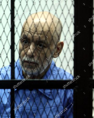 Stock Photo of Former Libyan Prime Minister Baghdadi Al-mahmoudi Looks on As He Sits Behind Bars During His Trial in Tripoli Libya 18 February 2014 Al-mahmoudi Faces Charges of Involvement in Crimes Under the Gaddafi Rule Which was Toppled in 2011 He Served As Prime Minister From 2006 Until August 2011 when He Fled to Tunisia After Insurgents Seized Control of Tripoli Virtually Ending Gaddafis 42-year Rule Tunisia Extradited Al-mahmoudi to Libya in June 2012 Libyan Arab Jamahiriya Tripoli