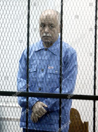 Former Libyan Prime Minister Baghdadi Al-mahmoudi Stands Behind Bars During His Trial in Tripoli Libya 08 January 2014 Al-mahmoudi Faces Charges of Involvement in Crimes Under the Gaddafi Rule Which was Toppled in 2011 He Served As Prime Minister From 2006 Until August 2011 when He Fled to Tunisia After Insurgents Seized Control of Tripoli Virtually Ending Gaddafis 42-year Rule Tunisia Extradited Al-mahmoudi to Libya in June 2012 Libyan Arab Jamahiriya Tripoli