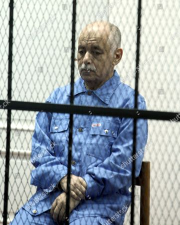 Former Libyan Prime Minister Baghdadi Al-mahmoudi Looks on As He Sits Behind Bars During His Trial in Tripoli Libya 08 January 2014 Al-mahmoudi Faces Charges of Involvement in Crimes Under the Gaddafi Rule Which was Toppled in 2011 He Served As Prime Minister From 2006 Until August 2011 when He Fled to Tunisia After Insurgents Seized Control of Tripoli Virtually Ending Gaddafis 42-year Rule Tunisia Extradited Al-mahmoudi to Libya in June 2012 Libyan Arab Jamahiriya Tripoli