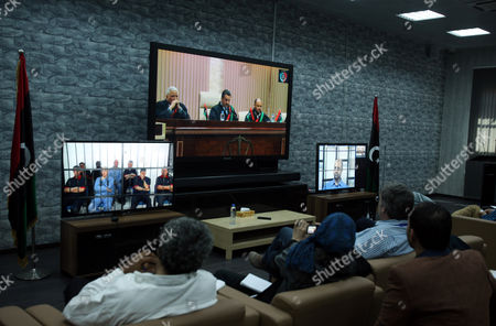 Journalists Watch Screens Broadcasting the Trial of Saif Al-islam (r) the Son of Former Libyan Leader Muammar Gaddafi Taking Place in Zintan to Journalists at a Courtroom in Tripoli Libya 27 April 2014 Two Sons of Former Libyan Leader Gaddafi Are Facing Charges For Crimes Allegedly Committed in an Attempt to Abort the Uprising That Toppled Their Father Saadi and Saif Al-islam Gaddafi Are Among 37 Defendants Facing Charges That Include Incitement to Kill and Rape Opponents Enlisting Mercenaries and Embezzlement of Public Funds and Other Abuses During the 2011 Uprising That Led to the Ouster and Killing of Gaddafi Libyan Arab Jamahiriya Tripoli