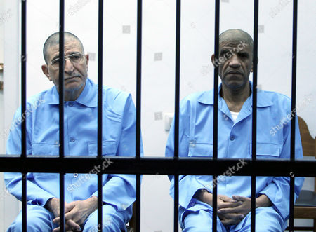 Former Libyan Foreign Intelligence Chief Bouzid Dorda (l) and Former Intelligence Chief Abdullah Senussi (r) Sit Behind Bars During Their Trial Along with Other Libyan Officials Under Former Libyan Leader Muammar Gaddafi at a Court Room in Tripoli Libya 27 April 2014 Two Sons of Former Libyan Leader Gaddafi Are Facing Charges For Crimes Allegedly Committed in an Attempt to Abort the Uprising That Toppled Their Father Saadi and Saif Al-islam Gaddafi Are Among 37 Defendants Facing Charges That Include Incitement to Kill and Rape Opponents Enlisting Mercenaries and Embezzlement of Public Funds and Other Abuses During the 2011 Uprising That Led to the Ouster and Killing of Gaddafi Libyan Arab Jamahiriya Tripoli