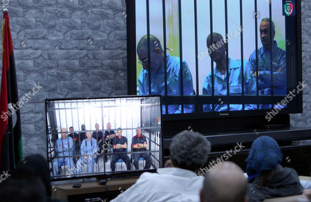 Journalists Watch Screens Broadcasting the Trial of Top Officials From the Era of Former Libyan Leader Muammar Gaddafi Taking Place in Zintan to Journalists at a Courtroom in Tripoli Libya 27 April 2014 Two Sons of Former Libyan Leader Gaddafi Are Facing Charges For Crimes Allegedly Committed in an Attempt to Abort the Uprising That Toppled Their Father Saadi and Saif Al-islam Gaddafi Are Among 37 Defendants Facing Charges That Include Incitement to Kill and Rape Opponents Enlisting Mercenaries and Embezzlement of Public Funds and Other Abuses During the 2011 Uprising That Led to the Ouster and Killing of Gaddafi Libyan Arab Jamahiriya Tripoli