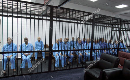 Former Libyan Officials From the Era of Former Libyan Leader Muammar Gaddafi Are Seen Behind Bars During Their Trial in Tripoli Libya 27 April 2014 Two Sons of Former Libyan Leader Gaddafi Are Facing Charges For Crimes Allegedly Committed in an Attempt to Abort the Uprising That Toppled Their Father Saadi and Saif Al-islam Gaddafi Are Among 37 Defendants Facing Charges That Include Incitement to Kill and Rape Opponents Enlisting Mercenaries and Embezzlement of Public Funds and Other Abuses During the 2011 Uprising That Led to the Ouster and Killing of Gaddafi Libyan Arab Jamahiriya Tripoli