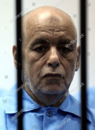 Former Libyan Prime Minister Baghdadi Al-mahmoudi Sits Behind Bars During His Trial Along with Other Libyan Officials Under Former Libyan Leader Muammar Gaddafi at a Court Room in Tripoli Libya 11 May 2014 Two Sons of Former Leader Mummar Gaddafi Are Among 37 Defendants Facing Charges That Include Incitement to Kill and Rape Opponents Enlisting Mercenaries and Embezzlement of Public Funds and Other Abuses During the 2011 Uprising That Led to the Ouster and Killing of Gaddafi Libyan Arab Jamahiriya Tripoli