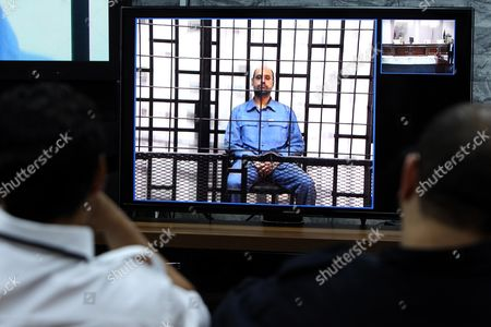 Journalists Watch Saif Al-islam the Son of Former Libyan Leader Muammar Gaddafi on a Screen Broadcasting His Trial Taking Place in Zintan to Journalists at a Courtroom in Tripoli Libya 11 May 2014 Two Sons of Former Leader Mummar Gaddafi Are Among 37 Defendants Facing Charges That Include Incitement to Kill and Rape Opponents Enlisting Mercenaries and Embezzlement of Public Funds and Other Abuses During the 2011 Uprising That Led to the Ouster and Killing of Gaddafi Libyan Arab Jamahiriya Tripoli
