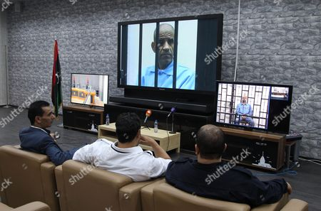 Journalists Watch Saif Al-islam (screen on R) the Son of Former Libyan Leader Muammar Gaddafi on a Screen Broadcasting His Trial Taking Place in Zintan to Journalists at a Courtroom in Tripoli Libya 11 May 2014 Two Sons of Former Leader Mummar Gaddafi Are Among 37 Defendants Facing Charges That Include Incitement to Kill and Rape Opponents Enlisting Mercenaries and Embezzlement of Public Funds and Other Abuses During the 2011 Uprising That Led to the Ouster and Killing of Gaddafi Libyan Arab Jamahiriya Tripoli