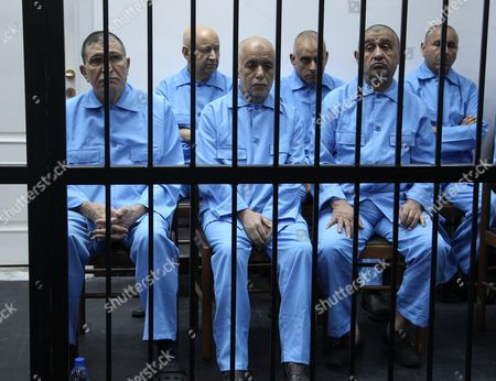 Former Libyan Foreign Intelligence Chief Bouzid Dorda (l Front Row) Former Libyan Prime Minister Baghdadi Al-mahmoudi (c Front Row) and Former Libyan Foreign Minister Abdelati Obeidi (r Front Row) Along with Other Unidentified Former Officials From the Era of Former Libyan Leader Muammar Gaddafi During Their Trial at a Court in Tripoli Libya 11 May 2014 Two Sons of Former Leader Mummar Gaddafi Are Among 37 Defendants Facing Charges That Include Incitement to Kill and Rape Opponents Enlisting Mercenaries and Embezzlement of Public Funds and Other Abuses During the 2011 Uprising That Led to the Ouster and Killing of Gaddafi Libyan Arab Jamahiriya Tripoli