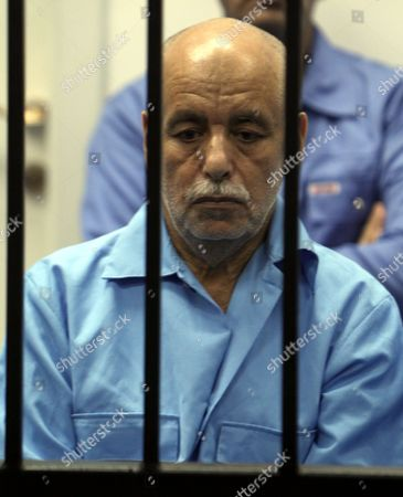 Stock Image of Former Libyan Prime Minister Baghdadi Al-mahmoudi Sits Behind Bars During His Trial Along with Other Libyan Officials Under Former Libyan Leader Muammar Gaddafi Attend Their Trial at a Court in Tripoli Libya 22 June 2014 Two Sons of Former Libyan Leader Gaddafi Along with More Than 30 Gaddafi-era Officials Were Expected to Appear in Court Facing Charges For Crimes They Allegedly Committed While Trying to Stop the Uprising That Ousted Gaddafi the 37 Defendants Face Charges Varying From Murder Kidnapping and Embezzlement of Public Funds As Well As Abuses During the 2011 Uprising That Led to the Ouster and Killing of Gaddafi Libyan Arab Jamahiriya Tripoli