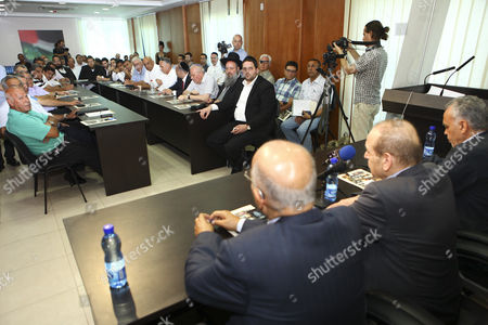 Secretary General of the Executive Committee Yasser Abed Rabbo (front 2-r) and a Member of the Palestinian Negotiating Team Nabil Shaath (front L) Attend a Meeting of Israeli Likud & Shas Party Members with Senior Palestinian Officials at Plo (palestinian Liberation Organization) Offices in Ramallah 07 July 2012 the Meeting was Organized by Geneva Initiative Organization and That was an Introductory Meeting to Discuss the Possibility of Resuming Direct Peace Talks Between the Plo Seniors and Israel's Likud and Shas Party Members - Ramallah