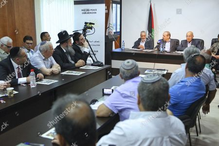 Stock Image of Secretary General of the Executive Committee Yasser Abed Rabbo (2-r on Podium) and a Member of the Palestinian Negotiating Team Nabil Shaath (r on Podium) Attend a Meeting of Israeli Likud & Shas Party Members with Senior Palestinian Officials at Plo (palestinian Liberation Organization) Offices in Ramallah 07 July 2012 the Meeting was Organized by Geneva Initiative Organization and That was an Introductory Meeting to Discuss the Possibility of Resuming Direct Peace Talks Between the Plo Seniors and Israel's Likud and Shas Party Members - Ramallah