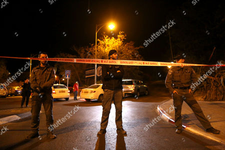 Israeli Police Guard Behind a Police Barrier Tape Close to the Crime Scene where a Motorcyclist Reportedly Shot Well Known Right-wing Activist Rabbi Yehuda Glick at the End of a Conference of the Jewish Temple Mount Faithful at the Menachem Begin Heritage Center in Jerusalem 29 October 2014 According to Media Reports the Shooter is Believed to Be a Palestinian Man Rabbi Glick who is Known For Preaching to Jews That They Should Pray Inside the Temple Mount was Transported to a Nearby Hospital and is Said to Be in Serious Condition Israel Jerusalem
