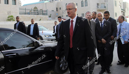 Palestinian Prime Minister Rami Hamdallah (c) Arrives to Attend the 33rd Graduation Ceremony at the Al - Najah University in the West Bank City of Nablus 09 June 2013 Hamdallah who Replaces Salam Fayyad was Sworn-in on 06 June is to Serve As Premier of the Palestinian Authority (pa) For Three Months Before President Mahmoud Abbas Takes Over Under a Unity Government to Be Formed Between the Rival Movements Fatah and Hamas - Nablus