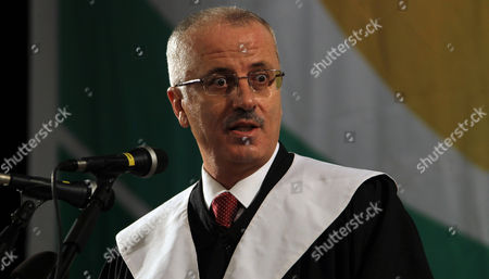 Palestinian Prime Minister Rami Hamdallah Delivers a Speech During the 33rd Graduation Ceremony at the Al - Najah University in the West Bank City of Nablus 09 June 2013 Hamdallah who Replaces Salam Fayyad was Sworn-in on 06 June is to Serve As Premier of the Palestinian Authority (pa) For Three Months Before President Mahmoud Abbas Takes Over Under a Unity Government to Be Formed Between the Rival Movements Fatah and Hamas - Nablus