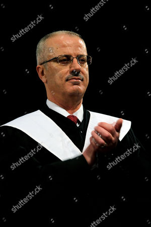 Palestinian Prime Minister Rami Hamdallah Claps During the 33rd Graduation Ceremony at the Al - Najah University in the West Bank City of Nablus 09 June 2013 Hamdallah who Replaces Salam Fayyad was Sworn-in on 06 June is to Serve As Premier of the Palestinian Authority (pa) For Three Months Before President Mahmoud Abbas Takes Over Under a Unity Government to Be Formed Between the Rival Movements Fatah and Hamas - Nablus
