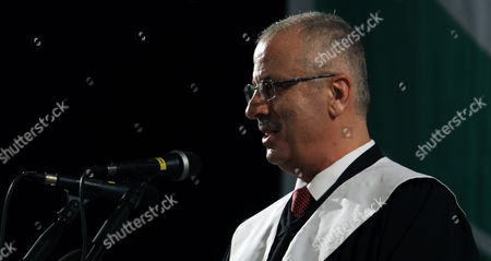 Stock Photo of Palestinian Prime Minister Rami Hamdallah Delivers a Speech During the 33rd Graduation Ceremony at the Al - Najah University in the West Bank City of Nablus 09 June 2013 Hamdallah who Replaces Salam Fayyad was Sworn-in on 06 June is to Serve As Premier of the Palestinian Authority (pa) For Three Months Before President Mahmoud Abbas Takes Over Under a Unity Government to Be Formed Between the Rival Movements Fatah and Hamas - Nablus