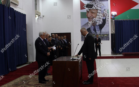 Palestinian Prime Minister Rami Hamdallah Swears in During the Oath Ceremony in the West Bank City of Ramallah 06 June 2013 Hamdallah and 24 Ministers on 06 June Took the Oath Before Palestinian President Mahmoud Abbas After a Decision of Reshuffling the Government Abbas Chose the 54-year-old Academic For the Post After Salam Fayyad Resigned in April and Asked Him to Form a Government - Ramallah