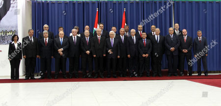 Palestinian President Mahmoud Abbas and Ministers of Reshuffled Government Pose For a Family Photo Following the Oath Ceremony in the West Bank City of Ramallah 06 June 2013 Rami Hamdallah and 24 Ministers on 06 June Took the Oath Before President Abbas who Chose the 54-year-old Academic For the Post After Salam Fayyad Resigned in April - Ramallah