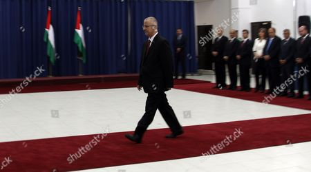 Palestinian Prime Minister Rami Hamdallah Walks to Be Sworn in During an Oath Ceremony in the West Bank City of Ramallah 06 June 2013 Hamdallah and 24 Ministers on 06 June Took the Oath Before Palestinian President Mahmoud Abbas After a Decision of Reshuffling the Government Abbas Chose the 54-year-old Academic For the Post After Salam Fayyad Resigned in April and Asked Him to Form a Government - Ramallah