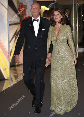 Stock Photo of Prince Serge of Yugoslavia Arrives with His Wife Eleonora at the 'Bal De La Rose' (rose Ball) For the 50th Anniversary of Princess Grace Foundation in Monaco 29 March 2014 the 'Bal De La Rose' is a Traditional Annual Charity Event in the Principality of Monaco Monaco Monaco