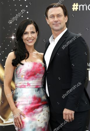 Us Actress Julie Benz (l) and New Zealand-born Actor Grant Bowler (r) Pose During a Photocall For the Tv Series 'Defiance' at the 54th Annual Monte Carlo Television Festival in Monaco 09 June 2014 the Festival Runs From 07 to 11 June Monaco Monaco