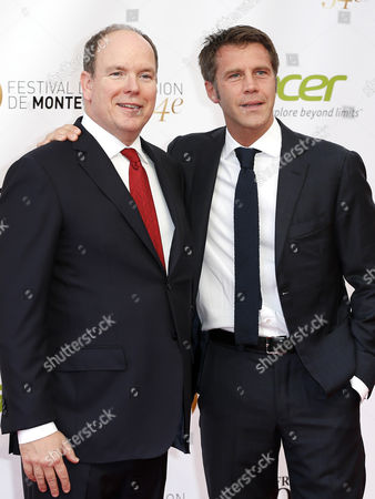 Prince Albert Ii of Monaco (l) and Italian Prince Emanuele Filiberto Di Savoia (r) Pose on the Red Carpet While Arriving For the Opening Ceremony of the Monte Carlo Television Festival in Monaco 07 June 2014 the Event Will Take Place From 07 to 11 June Monaco Monaco