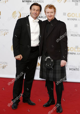 New Zealand Actor Grant Bowler (l) and Scottish Actor Tony Curran (r) Pose During the Closing Ceremony of the 54th Monte Carlo Television Festival in Monaco 11 June 2014 Monaco Monaco