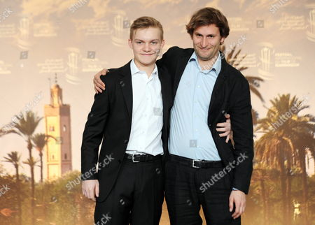Stock Photo of Swiss Director Simon Jaquemet (r) and Swiss Actor Benjamin Lutzke (l) Pose During the Photocall For 'Chrieg' at the 14th Annual Marrakech International Film Festival in Marrakech Morocco 11 December 2014 the Festival Runs From 05 to 13 December Morocco Marrakech