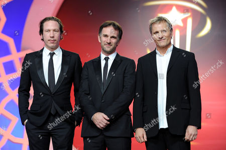 Danish-us Actor Viggo Mortensen (r) French Director David Oelhoffen (c) and French Actor Reda Kateb Stand Onstage During the Evening Tribute to Us Actor Viggo Mortensen As Part of the 14th Annual Marrakech International Film Festival in Marrakech Morocco 07 December 2014 the Festival Runs From 05 to 13 December Morocco Marrakech