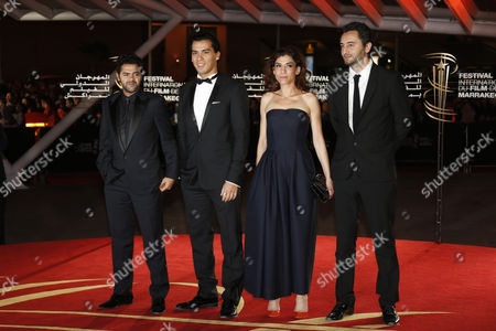 A Picture Dated 01 December 2013 (l-r) Shows French Actors Jamel Debbouze Tewfik Jallab Belgian Actress Lubna Azabal and French Actor Nader Boussandel Arriving For the Screening of 'La Marche' During the 13th Annual Marrakech International Film Festival Marrakech Morocco the Movie is Presented in the Official Competition of the Festival That Runs From 29 November to 07 December Morocco Marrakech