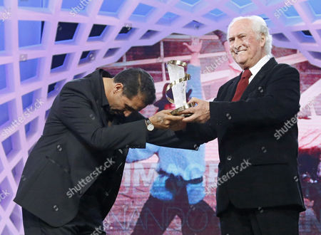 Stock Photo of Argentinian Film Director Fernando Solanas (r) Receives His Award From Morrocan Film Director Nour-eddine Lakhmari (l) For His Tribute During the 13th Annual Marrakech International Film Festival in Marrakech Morocco 05 December 2013 the Festival Runs From 29 November to 07 December Morocco Marrakech