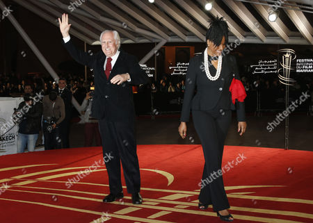 Argentinian Film Director Fernando Solanas (l) and His Wife Brazilian Actress Angel Correa (r) Arrive For His Tribute During the 13th Annual Marrakech International Film Festival in Marrakech Morocco 05 December 2013 the Festival Runs From 29 November to 07 December Morocco Marrakech