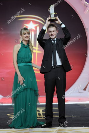 Stock Picture of Swiss Actor Benjamin Lutzke Poses Next to Member of the Jury French Actress Melanie Laurent (l) Holding Up His Award For Best Performance For the Movie 'Chrieg' at the Closing Ceremony During the 14th International Film Festival in Marrakech Morocco 13 December 2014 Morocco Marrakech