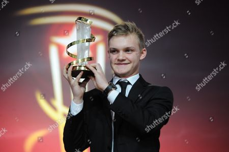 Swiss Actor Benjamin Lutzke Holds Up His Award For Best Performance For the Movie 'Chrieg' at the Closing Ceremony During the 14th International Film Festival in Marrakech Morocco 13 December 2014 Morocco Marrakech
