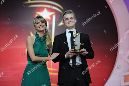 Stock Image of Swiss Actor Benjamin Lutzke Poses Next to Member of the Jury French Actress Melanie Laurent (l) Holding His Award For Best Performance For the Movie 'Chrieg' at the Closing Ceremony During the 14th International Film Festival in Marrakech Morocco 13 December 2014 Morocco Marrakech