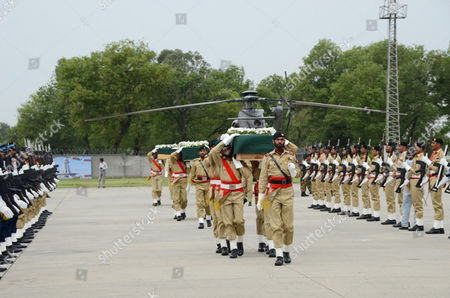 Members of the Pakistani Armed Forces Carry the Coffins of the Victims Killed in a Helicopter Crash After There Arrival at the Nur Khan Base in Chaklala Rawalpindi Pakistan 09 May 2015 the Ambassadors of Norway and the Phillipines Were Killed Along with the Spouses of the Indonesian and Malaysian Envoys and Three Crew Members when a Helicopter Crashed 08 May in the Northern Region of Gilgit-baltistan and Their Bodies Recovered From the Crash Site and Brought to Islamabad 09 May Pakistan Rawalpindi