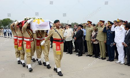 Members of the Pakistani Armed Forces Carry the Coffin of One of the Victims Killed in a Helicopter Crash After Its Arrival at the Nur Khan Base in Chaklala Rawalpindi Pakistan 09 May 2015 the Ambassadors of Norway and the Phillipines Were Killed Along with the Spouses of the Indonesian and Malaysian Envoys and Three Crew Members when a Helicopter Crashed 08 May in the Northern Region of Gilgit-baltistan and Their Bodies Recovered From the Crash Site and Brought to Islamabad 09 May Pakistan Rawalpindi
