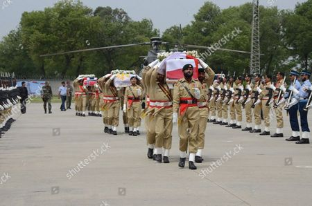 Pakistani Soldiers Carry the Coffins of Victims who Were Killed in the Crash of a Pakistani Military Helicopter Nur Khan Base in Chaklala Rawalpindi Pakistan 09 May 2015 the Ambassadors of Norway and the Phillipines Were Killed Along with the Spouses of the Indonesian and Malaysian Envoys and Three Crew Members when a Helicopter Crashed 08 May in the Northern Region of Gilgit-baltistan and Their Bodies Recovered From the Crash Site and Brought to Islamabad 09 May Pakistan Rawalpindi