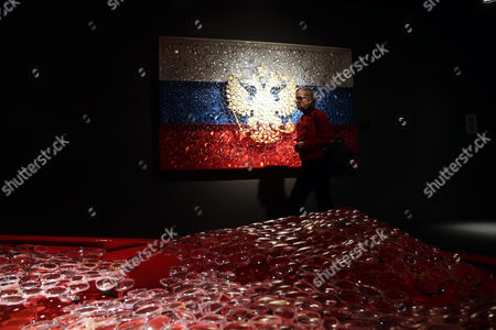 A Visitor Walks in Front of Artworks During the Opening of the 'Eyes to Eyes' Exhibition by a Georgian-born Us Artist David Datuna at the International Gallery Shchukin in Moscow Russia 18 October 2013 the Exhibition Runs From 18 October to 10 November Russian Federation Moscow