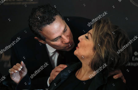 Us Conductor Eugene Kohn (l) Kisses Soprano Maria Guleghina During a Press Conference Before the Anniversary Concert 'Opera Ball' Devoted to the 75th Anniversary of of Opera Singer Elena Obraztsova in Moscow Russia 27 October 2014 the Concert Will Be Held on 28 October Russian Federation Moscow