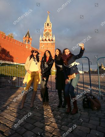'Miss Indonesia 2013' Whulandary (l) 'Miss Philippines 2013' Ariella Arida (2-l) 'Miss Canada 2013' Riza Santos (2-r) and 'Miss Lithuania 2013' Simona Burbaite (r) Pose For Photographs in Front of the Landmark Spasskaya Tower of the Moscow Kremlin During the '2013 Miss Universe Welcome Tour' Event on the Red Square in Moscow Russia 25 October 2013 the 2013 Miss Universe Pageant Will Take Place at the Crocus City Hall in Moscow on 09 November 2013 Russian Federation Moscow