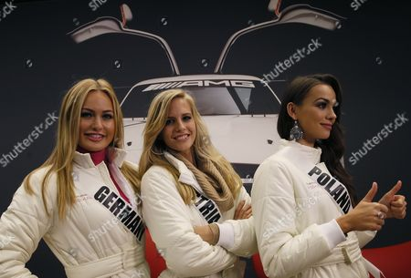 Miss Germany 2013 Anne Julia Hagen (l) Miss Austria 2013 Doris Hofmann (c) and Miss Poland 2013 Paulina Krupinska Pose For the Media Before Amg Test Drive at Mersedes-benz in Raceway Track 90 Km Outside Moscow Russia 28 October 2013 the 2013 Miss Universe Pageant Will Take Place at the Crocus City Hall in Moscow on 09 November Russian Federation Moscow