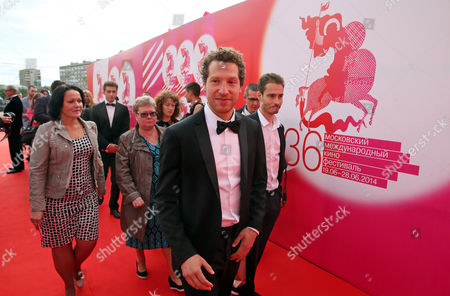 Stock Image of Us Director of the Movie 'Red Army' Gabriel Polsky (c) Walks on the Red Carpet During the Opening Ceremony of the 36th Moscow International Film Festival in Moscow Russia 19 June 2014 the 36th Moscow Film Festival Opens with the Film 'Red Army' a Documentary About the Great 1980s Russian Cska Hockey Team the Event Will Run From 19 to 28 June Russian Federation Moscow