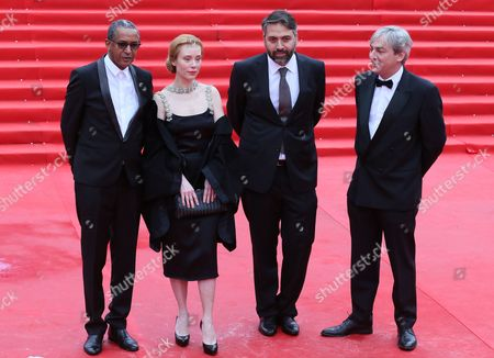 Jury Members (l-r) Mauritanian Director Abderrahmane Sissako German Actress Franziska Petri Georgian Director Levan Koguashvili and French Producer of Rezo Films Laurent Danielo Arrive For the Closing Ceremony of the 36th Moscow International Film Festival in Moscow Russia 28 June 2014 Russian Federation Moscow