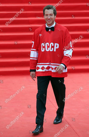 Stock Photo of Us Director of the Movie 'Red Army' Gabriel Polsky Dressed in a Hockey Jersey Reading 'Ussr' Walks on the Red Carpet During the Opening Ceremony of the 36th Moscow International Film Festival in Moscow Russia 19 June 2014 the 36th Moscow Film Festival Opens with the Film 'Red Army' a Documentary About the Great 1980s Russian Cska Hockey Team the Event Will Run From 19 to 28 June Russian Federation Moscow