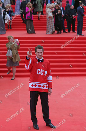 Stock Picture of Us Director of the Movie 'Red Army' Gabriel Polsky Dressed in a Hockey Jersey Reading 'Ussr' Gestures on the Red Carpet During the Opening Ceremony of the 36th Moscow International Film Festival in Moscow Russia 19 June 2014 the 36th Moscow Film Festival Opens with the Film 'Red Army' a Documentary About the Great 1980s Russian Cska Hockey Team the Event Will Run From 19 to 28 June Russian Federation Moscow
