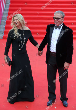 Russian Hockey Legend and Russian Minister of Sport Viacheslav Fetisov (r) and His Wife Ladlena Pose For Pictures on the Red Carpet at the Opening Ceremony of the 36th Moscow International Film Festival in Moscow Russia 19 June 2014 the 36th Moscow Film Festival Opens with a Film 'Red Army' a Documentary About the Great 1980s Russian Cska Hockey Team Russian Federation Moscow